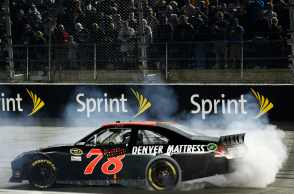 Regan Smith celebrates winning the Showtime Southern 500 with a burnout at Darlington Raceway - Photo Credit: Chris Graythen/Getty Images
