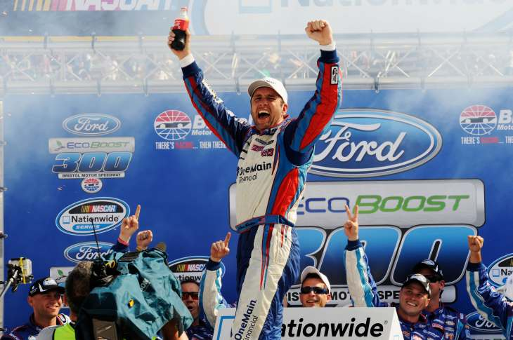 Elliott Sadler celebrates in Bristol Motor Speedway Victory Lane on Saturday after winning the NASCAR Nationwide Series Ford EcoBoost 300 in Bristol, Tenn. - Photo Credit: John Harrelson/Getty Images for NASCAR