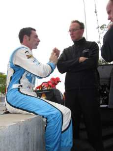 Simon Pagenaud Talks with Sam Schmidt Motorsports Crew Members