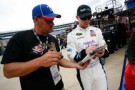 Denny Hamlin signs an autograph during practice - Photo Credit: Tyler Barrick/Getty Images for NASCAR