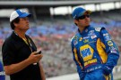 Michael Waltrip talks with Martin Truex Jr., driver of the #56 NAPA Auto Parts Toyota - Photo Credit: Tom Pennington/Getty Images for NASCAR