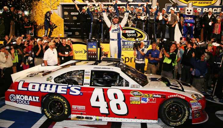 Jimmie Johnson, driver of the No. 48 Lowe's Patriotic Chevrolet, celebrates in Victory Lane after winning the NASCAR Sprint All-Star Race at Charlotte Motor Speedway on Saturday in Concord, N.C. - Photo Credit: Jerry Markland/Getty Images for NASCAR
