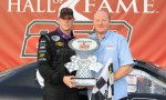 Brandon McReynolds (left) stands with his father Larry McReynolds (right) hold the ARCA Racing Series International Motorsports Hall of Fame 250 Trophy in Victory Lane at Talladega Superspeedway
