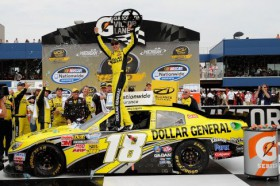 Joey Logano, driver of the No. 18 Dollar General Toyota, celebrate sin Victory Lane after winning the NASCAR Nationwide Series Alliance Truck Parts 250 at Michigan International Speedway on Saturday in Brooklyn, Mich. - Photo Credit: John Harrelson/Getty Images for NASCAR