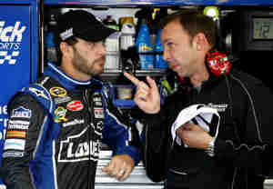 Jimmie Johnson, driver of the No. 48 Lowe&#039;s Chevrolet talks with crew chief Chad Knaus - Photo Credit: Jeff Zelevansky/Getty Images for NASCAR