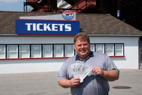 New Hampshire Motor Speedway's Executive VP and GM,Jerry Gappens, Holds Race Tickets for U.S. President Obama