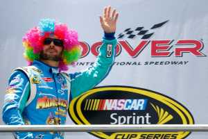 Jimmie Johnson, driver of the #48 Lowe&#039;s Madagascar Chevrolet, wears a rainbow wig during pre race ceremonies for the NASCAR Sprint Cup Series FedEx 400 benefiting Autism Speaks at Dover International Speedway on June 3, 2012 in Dover, Delaware. (Photo by Geoff Burke/Getty Images)