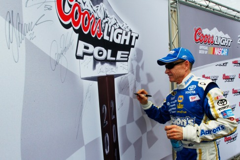 Mark Martin, driver of the #55 Aaron's Dream Machine Toyota, signs the Coors Light Pole Board after qualifying for pole position for the NASCAR Sprint Cup Series FedEx 400 benefiting Autism Speaks at Dover International Speedway on June 2, 2012 in Dover, Delaware. (Photo by Geoff Burke/Getty Images)