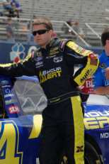Ragan stands next to his 8-Hour Alert Ford