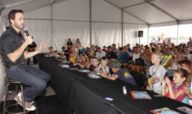 Jimmie Johnson answers questions from children during the Quicken Loans 400 in June (photo credit: LAT USA).