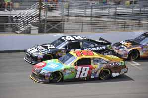 Kyle Busch Battles with Jimmie Johnson at Indy - Photo Credit: Jim Haines for IMS