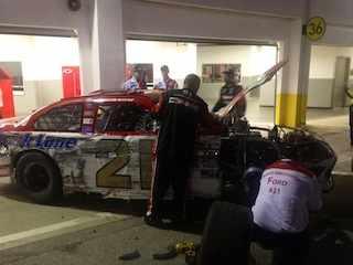 The Wrecked No. 21 Motorcraft Quick Lane Ford in Garage