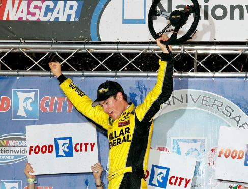 Joey Logano, driver of the #18 Dollar General Toyota, celebrates in Victory Lane after winning the NASCAR Nationwide Series Food City 250 at Bristol Motor Speedway on August 24, 2012 in Bristol, Tenn. - Photo Credit: Tyler Barrick/Getty Images for NASCAR