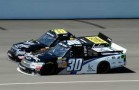 Nelson Piquet Jr. (30) and Kurt Busch battle for the lead during the VFW 200 at Michigan International Speedway. - Photo Credit: Jared C. Tilton/Getty Images for NASCAR