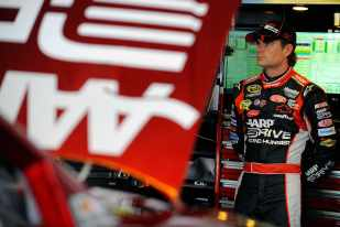 Jeff Gordon, driver of the #24 Drive to End Hunger Chevrolet, stands in the garage - Photo Credit: Jared C. Tilton/Getty Images for NASCAR