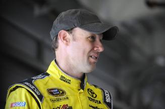 Matt Kenseth, driver of the #20 Toyota, stands in the garage area during NASCAR Sprint Cup Series Preseason Thunder testing at Daytona International Speedway in Daytona Beach, Florida. - Photo Credit: Jared C. Tilton/Getty Images