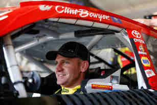 Clint Bowyer, driver of the #15 5-hour Energy Toyota, sits in his car during practice for the NASCAR Sprint Cup Series Auto Club 400 at Auto Club Speedway on March 22, 2013 in Fontana, California. - Photo Credit: Chris Graythen/Getty Images