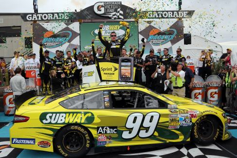 Carl Edwards, driver of the #99 Subway Ford, celebrates in victory lane after winning the NASCAR Sprint Cup Series Subway Fresh Fit 500 at Phoenix International Raceway on March 3, 2013 in Avondale, Arizona. - Photo Credit: Jonathan Ferrey/Getty Images