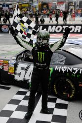 Kyle Busch, driver of the #54 Monster Energy Toyota, celebrates after winning the NASCAR Nationwide Series Jeff Foxworthy's Grit Chips 300 at Bristol Motor Speedway on March 16, 2013 in Bristol, Tennessee. (Photo by Jared C. Tilton / Getty Images)
