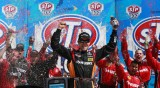 Matt Kenseth, driver of the #20 The Home Depot/Husky Toyota, celebrates in Victory Lane after winning the NASCAR Sprint Cup Series STP 400 at Kansas Speedway on April 21, 2013 in Kansas City, Kansas. - Photo Creit: Chris Trotman/Getty Images
