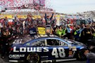 Jimmie Johnson, driver of the #48 Lowe's Chevrolet, celebrates in Victory Lane after winning the NASCAR Sprint Cup Series STP Gas Booster 500 on April 7, 2013 at Martinsville Speedway in Ridgeway, Virginia. - Photo Credit: Jerry Markland/Getty Images