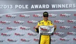 Matt Kenseth, driver of the #20 Dollar General Toyota, poses in Victory Lane after qualifying for the pole position in the NASCAR Sprint Cup Series Toyota Owners 400 at Richmond International Raceway on April 26, 2013 in Richmond, Virginia. (Photo by Streeter Lecka/Getty Images)