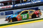 Kyle Busch, driver of the #18 M&amp;M&#039;s Toyota, and Kasey Kahne, driver of the #5 Farmers Insurance Chevrolet, race during the NASCAR Sprint Cup Series STP Gas Booster 500 on April 7, 2013 at Martinsville Speedway in Ridgeway, Virginia. - Photo Credit: John Harrelson/Getty Images