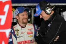 (L-R) Dale Earnhardt Jr., driver of the #88 National Guard Chevrolet, talks with crew chief Steve Letarte - Photo Credit: Todd Warshaw/Getty Images
