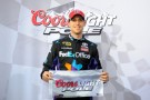 Denny Hamlin, driver of the #11 FedEx Office Toyota, poses in Victory Lane after qualifying for the pole position in the NASCAR Sprint Cup Series Coca-Cola 600 at Charlotte Motor Speedway on May 23, 2013 in Concord, North Carolina. - Photo Credit: Jared C. Tilton/Getty Images