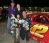 Augie Grill celebrates his first Southern Super Series presented by Sunoco victory at Montgomery with his family; father Frankie, wife Courtney and young sons Owen and Nayson. (Photo Credit: Speed 51)