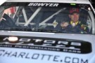 Clint Bowyer, driver of the #15 RK Motors Toyota, sits in his car - Photo Credit: Jamey Price/Getty Images