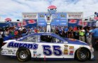 Brian Vickers, driver of the #55 Aaron's Dream Machine Toyota, celebrates in Victory Lane after winning the NASCAR Sprint Cup Series Camping World RV Sales 301 at New Hampshire Motor Speedway on July 14, 2013 in Loudon, New Hampshire. - Photo Credit: Jerry Markland/Getty Images
