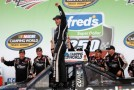 Johnny Sauter, driver of the #98 Carolina Nut / Curb Records Toyota, celebrates in Victory Lane after winning the Camping World Truck Series Fred's 250 Powered By Coca-Cola at Talladega Superspeedway on October 19, 2013 in Talladega, Alabama. - Photo Credit: Chris Graythen/Getty Images