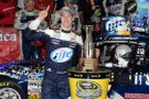 Brad Keselowski, driver of the #2 Miller Lite Ford, poses with the trophy in Victory Lane after winning the NASCAR Sprint Cup Series Bank of America 500 at Charlotte Motor Speedway on October 12, 2013 in Concord, North Carolina. - Photo Credit: John Harrelson/Getty Images