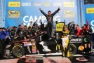 (R) Jamie McMurray, driver of the #1 Cessna Chevrolet, celebrates in Victory Lane with crew members after winning the NASCAR Sprint Cup Series Camping World RV Sales 500 at Talladega Superspeedway on October 20, 2013 in Talladega, Alabama. - Photo Credit: Jerry Markland/Getty Images