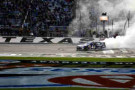 Jimmie Johnson, driver of the #48 Lowe's Chevrolet, celebrates with a burnout after winning the NASCAR Sprint Cup Series AAA Texas 500 at Texas Motor Speedway on November 3, 2013 in Fort Worth, Texas. - Photo Credit: Chris Graythen/Getty Images