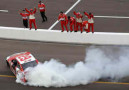 Kevin Harvick, driver of the #29 Budweiser Chevrolet, celebrates with a burnout after winning the NASCAR Sprint Cup Series AdvoCare 500 at Phoenix International Raceway on November 10, 2013 in Avondale, Arizona. - Photo Credit: Todd Warshaw/Getty Images