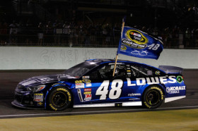 Jimmie Johnson, driver of the #48 Lowe's/Kobalt Tools Chevrolet, celebrates after winning the series championship after the NASCAR Sprint Cup Series Ford EcoBoost 400 at Homestead-Miami Speedway on November 17, 2013 in Homestead, Florida. - Photo Credit: Getty Images for NASCAR