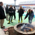 Miss Sprint Cups and USA Today's Jeff Gluck roast marshmallows outside the Charlotte Motor Speedway media center. Credit CMS/HHP