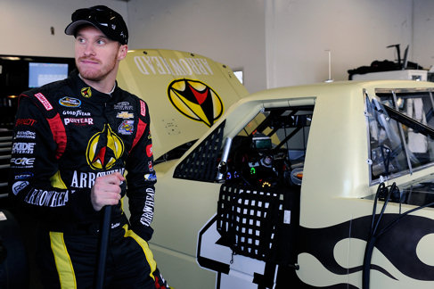 Jeb Burton, driver of the #4 Turner Scott Motorsports Chevrolet, stands in the garage area during NASCAR Preseason Thunder at Daytona International Speedway on January 13, 2014 in Daytona Beach, Florida. - Photo Credit: Jared C. Tilton/Getty Images