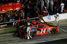 Tony Stewart, driver of the #14 Bass Pro Shops / Mobil 1 Chevrolet, pits for faulty fuel fuel pressure during the NASCAR Sprint Cup Series Daytona 500 at Daytona International Speedway on February 23, 2014 in Daytona Beach, Florida. - Photo Credit: Brian Lawdermilk/Getty Images