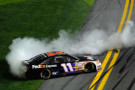 Denny Hamlin, driver of the #11 FedEx Express Toyota, celebrates with a burnout after winning the NASCAR Sprint Cup Series Sprint Unlimited at Daytona International Speedway on February 15, 2014 in Daytona Beach, Florida. - Photo Credit: Jared C. Tilton/Getty Images