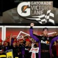 Denny Hamlin, driver of the #11 FedEx Express Toyota, celebrates in Victory Lane after winning during the NASCAR Sprint Cup Series Budweiser Duel 2 at Daytona International Speedway on February 20, 2014 in Daytona Beach, Florida. - Photo Credit: Tom Pennington/Getty Images