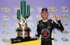 Kevin Harvick, driver of the #4 Jimmy John's Chevrolet, celebrates in Victory Lane with the trophy after winning the NASCAR Sprint Cup Series The Profit On CNBC 500 at Phoenix International Raceway on March 2, 2014 in Avondale, Arizona. - Photo Credit: Jerry Markland/Getty Images