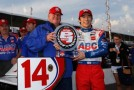 (L) Team owner A.J. Foyt and (R) Takuma Sato of Japan driver of the #14 ABC Supply A.J. Foyt Racing Honda pose with Verizon P1 Pole Award for the Verizon IndyCar Series Firestone Grand Prix of St. Petersburg at the Streets of St. Petersburg on March 29, 2014 in St Petersburg, Florida. - Photo Credit: Chris Trotman/Getty Images