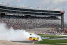 Joey Logano, driver of the #22 Shell-Pennzoil/Hertz Ford, celebrates with a burnout after winning the NASCAR Nationwide Series O'Reilly Auto Parts 300 at Texas Motor Speedway on April 4, 2014 in Fort Worth, Texas. - Photo Credit: Jeff Gross/Getty Images
