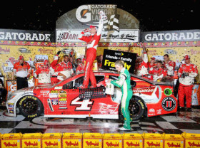 Kevin Harvick, driver of the #4 Budweiser Chevrolet, celebrates in Victory Lane after winning the NASCAR Sprint Cup Series Bojangles' Southern 500 at Darlington Raceway on April 12, 2014 in Darlington, South Carolina. - Photo Credit: Jerry Markland/Getty Images