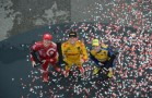 Scott Dixon, Ryan Hunter-Reay, and Marco Andretti pose on the podium following the 2014 Honda Indy Grand Prix of Alabama - Photo Credit: Eric Anderson for INDYCAR