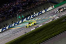 Kyle Busch, driver of the #51 Dollar General Toyota, takes the checkered flag to win the NASCAR Camping World Series UNOH 225 at Kentucky Speedway on June 26, 2014 in Sparta, Kentucky. - Photo Credit: Sean Gardner/Getty Images