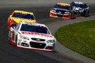 Dale Earnhardt Jr., driver of the #88 National Guard Chevrolet, leads a pack of cars during the NASCAR Sprint Cup Series Pocono 400 at Pocono Raceway on June 8, 2014 in Long Pond, Pennsylvania. - PhotoCredit: Jeff Zelevansky/Getty Images